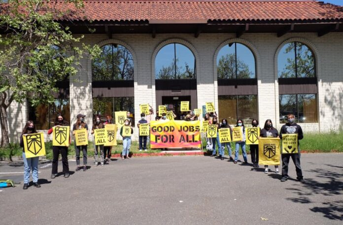Members of Sunrise Movement Sonoma County rally in front of Rep. Mike Thompson's office in Santa Rosa, California.